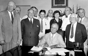 Signing the Social Security Act, 1935