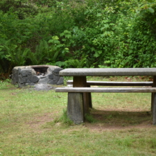 Picnic table and stone fireplace,Patrick's Point State Park - Trinidad CA